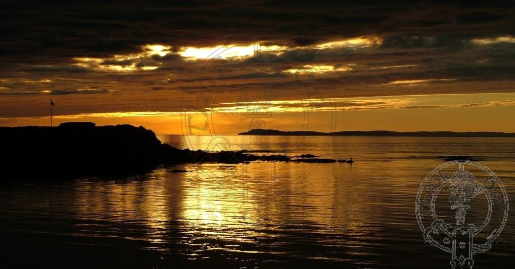 Sunset over Uisead Point and Islay, looking from Machrihanish